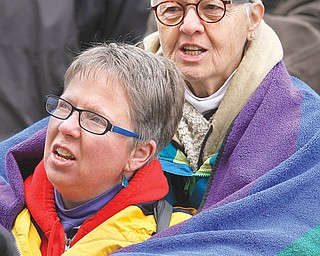 Glorianne Leck of Bloomington, Ind., wraps a blanket around her partner, Susan Savastuk, during a March 2011 rally at the Indiana Statehouse. Leck and Savastuk had a commitment ceremony in Youngstown in 1995 and support same-sex marriage.