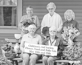 The Friends of Children's Aid Society of Mercer County will host their annual flower, yard and bake sale from 9 a.m. to 4 p.m. Friday and from 9 a.m. to 1 p.m. Saturday on the grounds of the Children's Aid Society, 350 W. Market St., Mercer, Pa. Pre-ordered flowers will be available for pickup after noon Thursday, or during sale hours. Preparing for the event are society members, standing from left, Carol Clark, Joan Foster and Julie Amholt. Seated are Liz Bolster and Julia Adams. Proceeds from the sale will benefit the Carol L. Smith Educational Scholarship at Children's Aid Society.