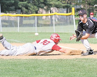 Niles baserunner Patrick Barrett dives back into first base as Canfield's Tony Mehle awaits a throw during a recent game at Canfield. Thursday, Canfield will play Poland at Cene Park in a Division II district semifinal.