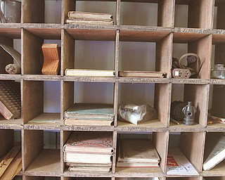 Wooden boxes still hold books and items collected from one-room schoolhouses throughout Mercer County.