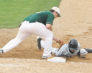 Crestview's Austin Eskra (10) scrambles back to the bag as Ursuline's Sam Donko (13) applies the tag during a Division III district semifinal baseball game Monday at Cene Park in Struthers. The Irish downed the Rebels, 4-1, and will defend their title in the district championship today against Girard. The game will get underway at 7 p.m. at Cene Park.
