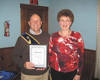 Debbie Pifer, right, manager of White House Fruit Farm in Canfield, was recently honored as Outstanding Community Citizen of the Year by the Dublin Grange in Canfield. Grange lecturer Gary Reel, who presented a history of the group, was honored as a past master.