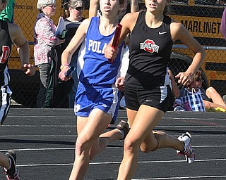 (816) of Poland and (104) of Salem are stride for stride during the 4 x 400 meter relay Thursday afternoon in Salem. - Nick Mays l The Vindicator
