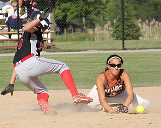 Girard baserunner Callie Jay (16,left) attempts to slide back to second base before being tagged by Carly Blair (8,right) of East Palestine during Thursdays district championship game at South Range High School in Canfield. Dustin Livesay  |  The Vindicator