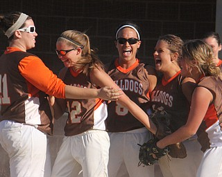 Members of the East Palestine softball team celebrate after getting the third out to beat Girard during Thursdays district championship game at South Range High School in Canfield. Dustin Livesay  |  The Vindicator