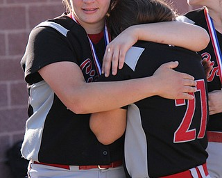 Girards senior Mickey Sigurani gets held by teammate Neco Maderitz (left) after her team lost Thursdays district championship game against East Palestine at South Range High School in Canfield. Dustin Livesay  |  The Vindicator