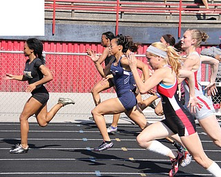 Junior Aminah Wesley of Warren G. Harding leads the pack during the half way mark of the 100 meter dash during Fridays Division one district championship track meet at Austintown Fitch High School.  Dustin Livesay  |  The Vindicator