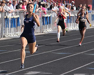 Theresa Scott of Fitch runs far out front of the pack helping her 4x100 meter relay team of Jenna Yacovone, Ebony Davis, and Amber Brown win the race and set a new district record during Fridays Division one district championship track meet at Austintown Fitch High School.  Dustin Livesay  |  The Vindicator