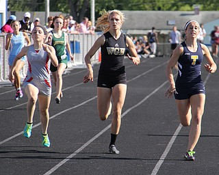 (L-R) Emily Deering of Geneva, Emily Stevens of Warren Harding, and Hallie Allen of Tallmadge match each other step by step across the finish line of the 400 meter run during Fridays Division one district championship track meet at Austintown Fitch High School.  Dustin Livesay  |  The Vindicator