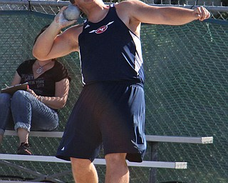 Billy Price of Austintown Fitch comes around his final spin and prepares to release the shot put during Fridays Division one district championship track meet at Austintown Fitch High School.  Dustin Livesay  |  The Vindicator