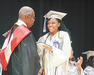 Graduate Kenisha Coleman, 17, receives her diploma from Youngstown Board of Education President Lock P. Beachum Sr. during the commencement ceremony for the 2012 graduating class of Youngstown Early College on Sunday in Powers Auditorium.