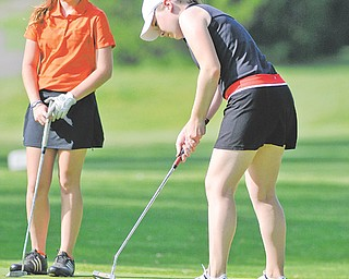 Caitlyn Butler, left, watches as Kerra Loomis lines up a putt during Sunday's first-round qualifier in the Girls U-17 Division for The Greatest Junior Golfer of the Valley tournament at Pine Lakes Golf Club in Hubbard. The top two boys and girls in each division (U-17 and U-14) advanced to the championship final set for July 21 at Trumbull Country Club. Butler finished tied for third with a 91, and Loomis finished in fifth with a 96.