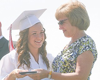 Graduate Sara Posey receives her diploma from her mother, Lori Posey, treasurer for the Columbiana Board of Education, during the commencement ceremony.