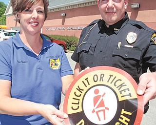 Susan Viars, left, of Mahoning County Safe Communities and Scott Weamer, Canfield assistant police chief, discussed the kickoff of the national Click it or Ticket campaign. The campaign runs through June 3 and is designed to educate drivers about the dangers of not wearing a seat belt. Weamer said anyone pulled over
