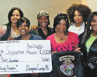 "Dangerous Curvez MC is an all-female local motorcycle club of professional women. The group has participated in and sponsored many fundraisers in the community and recently presented a donation to Audrey Walker, front row, left, of Soujourner House, a shelter for battered women. Also in the front row are Gwen ""Sugafree"" Bell, club president, and Camesha ""Hypnotic"" Edmonds, vice president. In the back row, from left, are Yatasha ""Freeway"" Jefferson, treasurer; Sondra ""Honey"" Jones, co-founder; and Melanie ""SweetH20"" Ross, business manager."