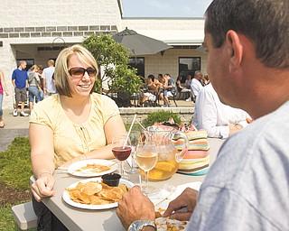 Lisa Grafton of Hinckley and Gary Poage of Salem enjoy wine at Mastropiétro Winery.