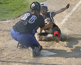 JESSICA M. KANALAS  | THE VINDICATOR..Mathews #15 Tabby Granelly is tagged out at home plate during the top of the fourth inning against Jackson Milton for the Division 3 Regional Semifinal game at Kent State University.