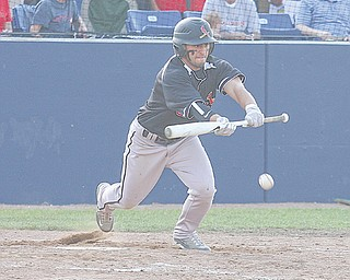 Canfield's Ben Angelo lays down a bunt during a Division II regional semifinal baseball game against Canton South on Thursday at The Ballpark at Hudson High School. The Cardinals dominated the Wildcats, 14-1, to advance to the regional final today against Mentor Lake Catholic.