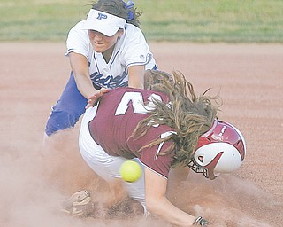 Kalie Benson (21) of Poland and Samantha Schneider (2) collide at second base during the sixth inning of their Division II regional semifinal softball game Thursday at Firestone Stadium in Akron. Poland held on to defeat Woodridge, 3-2, and advance to the final Saturday against Akron Hoban.