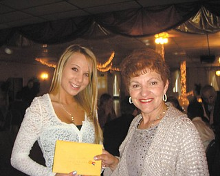 Roselyn Gadd, right, of Girard Junior Women, presents a scholarship to Sahara Stauffer of Girard High School. The organization is dedicated to raising money for the Girard community, and student scholarships are a priority on the project list. The group also recently donated to the Emmanuel Center and has plans to plant flowers in downtown Girard. New members are welcome. For information visit the Girard Junior Women Facebook page.