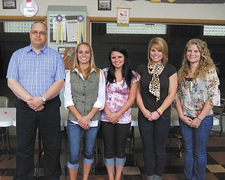 The Struthers Rotary has announced the names of the winners of its 2012 Struthers High School $500 scholarships. Rotary scholarships are awarded on the basis of participation in activities and organizations that serve the community by helping others. The group also presented the $500 2012 William Comstock Scholarship, given in the name of a former Struthers High School teacher and member of the Board of Education and Rotary. Rotarian Tom Baringer, scholarship chairman, stands with scholarship recipients, from left, Samantha Basista, Ellie Bodnar, Katie Jordan and Leighan Wells. Jordan is the winner of this year's William Comstock Scholarship.