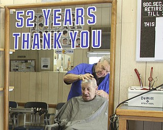 William D Lewis The Vindicator    Long time Youngstown barber Cosmo Pecchia gives a trim to Tom Shimet of Girard. Pecchia opened the shopin 1962 in the house on Oak St where he grew up.