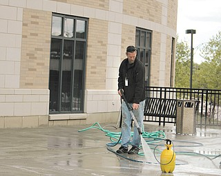 A worker sprays down the exterior walkway at the Nathaniel R. Jones Federal Building and U.S. Courthouse on Wick Avenue in downtown Youngstown. Exterior repairs to the structure are expected to be finished later this spring.