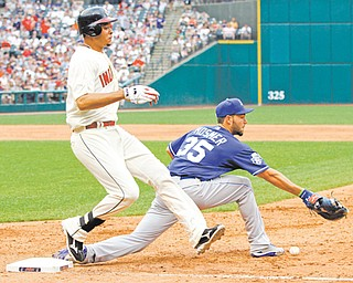 Cleveland Indians' Juan Diaz reaches first base on an error by Kansas City Royals first baseman Eric Hosmer (35) in the seventh inning of Monday's baseball game in Cleveland. The Indians held off the Royals to win 8-5.
