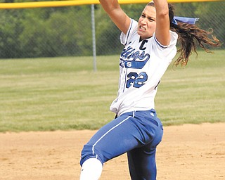 Poland ace Erin Gabriel has worn red shoes since her softball career began. A superstitious player, she did not break the tradition when she made the varsity even though the Bulldogs' colors are blue and white.