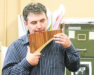 Fedoriouk plays a pan flute.