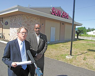 Ohio Attorney General Mike DeWine, left, stands with Warren Mayor Doug Franklin in front of Sun Spa, 2819 W. Market St. NW, just after agents and Warren police raided it and seven other massage parlors Wednesday.