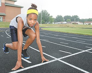 Youngstown Christian School's Destinee Snyder never ran track before this season and only joined the program after her AAU basketball season was canceled. This weekend, the 14-year-old freshman will be the first student in YCS history to compete in a state track meet. Snyder's event is the 400-meter dash, in which she won a Division III district title and ran for a fourth-place finish in the regional meet to qualify for state.