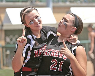 ROBERT K. YOSAY | THE VINDICATOR..Happy Days to STATE -   #2 Olivia Rhondanz and  Jacki Rhine celebrate after beating Covington to advance to the state championshp .A couple of bloop hits combined with a three-base error on a sacrifice bunt to propel the Mathews High softball team to its biggest game in school history..Junioir shortstop Jessica Marsico drove in two runs plus made a sliding catch in right field in the seventh inning to help the Mustangs defeat Covington, 5-3, in ThursdayÕs Division IV state semifinal game at Firestone Stadium.. - -30-..
