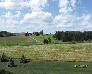 Here's a country scene in Holmes County, Ohio, sent in by J.E. Ferrett of Hubbard.
