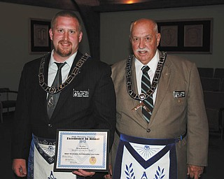 At a special meeting May 25 at Argus Lodge, Brother Ryan Hamilton, left, was presented with the 24th Masonic District Excellence in Ritual award recently for the best entered apprentice lecture. He is the son of Rodney and Linda Hamilton, all of Canfield. Hamilton is a graduate of Youngstown State University, where he earned a bachelor's degree in history. He is employed as a group leader at General Motors in Lordstown. Worshipful Brother Thomas J. Hallden, right, is shown with Hamilton.