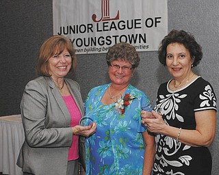 The Junior League of Youngstown introduced two new awards at its annual dinner May 8 at Mr. Anthony's in Boardman. The JLY Milestone Award was presented to Suzanne Fleming, left, and the JLY Service Award to Deb Hartig, right. Outgoing JLY president, Susan Stewart, is in the center. The Milestone Award is intended for a woman who has demonstrated outstanding leadership in the League, and has paved the way for future members. Fleming, of Youngstown, joined the group in 1973 and has held several offices, including president from 1983-1985. The Service Award honors a woman who acts as a role model and shares her talents through effective volunteer service. Hartig, of Struthers, has the distinction of being the League's longest serving active member, a status that she has maintained for 20 years.