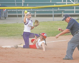 Champion's Darian Rogers (4) holds up the ball to prove possession after tagging out Felicity-Franklin's Sandy Woodmansee (1) during the bottom of the first inning of the Division III state softball semifinal Thursday at Firestone Stadium in Akron. The Golden Flashes rallied from a 4-0 deficit to defeat the Cardinals, 6-4.