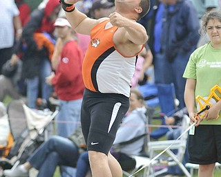 Stephen Lyons of Springfield throws the shot put Friday afternoon at the State Track Meet in Columbus.
