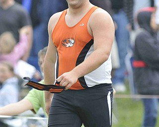 Stephen Lyons of Springfield smiles after hearing the cheers from his friends and family after throwing the shot put Friday afternoon at the State Track Meet in Columbus.