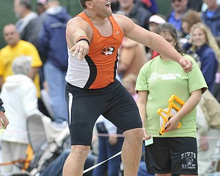 Stephen Lyons screams after throwing the shot put Friday afternoon at the State Track Meet in Columbus.