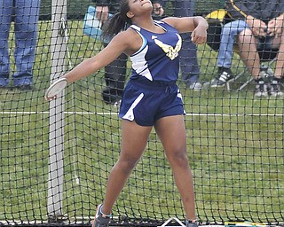 Jai'Lyn Mosley of McDonald throws the discus Friday afternoon at the State Track Meet in Columbus. She would finish second in divison three.