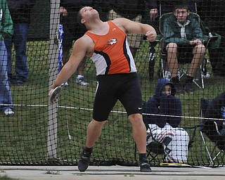 Springfield's Stephen Lyons throws the discus during the boys discus Friday afternoon in Columbus.