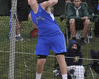 Maplewood's Stephen Pop throws the discus during the boys discus Friday afternoon in Columbus.