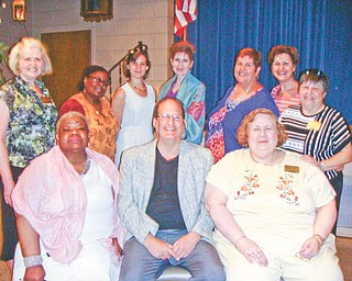 """Officers and directors of the League of Women Voters of Greater Youngstown met recently at the Youngstown Saxon Club for an installation ceremony. Seated, from left, are Corliss Green, Terrance Esarco and Anne Harpman. Standing are Dorothy Kane, Gwen Fish, Sarah Lowry, Stephanie Danes Smith, Kathleen Dragoman, Suzanne Barbati and Karen Lazarus. Absent is Michele McBride Simonelli. The group is nonpartisan and publishes the """"Voters Guide"""" for the general election. Those interested in joining can visit the Web at www.lwvgy.org."""