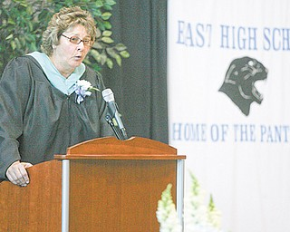 East High Principal Holly Seimetz speaks to graduates and their families during the East High School commencement Sunday.