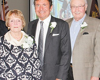 Recipients of Salvation Army of Mahoning County awards presented at the Civic Dinner on Tuesday are, from left: Carol J. Bigelow, OTHERS Award; and Sam Covelli and Dale Sheely Sr., who each received the Distinguished Community Service Award.