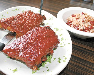 Baby Back Ribs with a side of Rice from the Phoenix Fire Grill and Bar.
