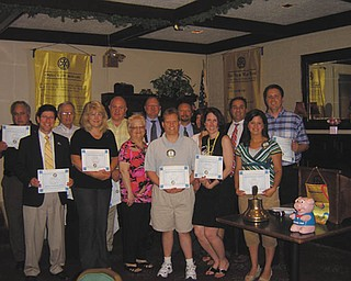 Members of Austintown Rotary received honors for perfect attendance recently. In the back row, from left to right, are Jerry Haber, Tony Cebriak, Mal Culp, Chuck Baker, Mark Cole, Hillary Prestridge (partly obscured) Vince Colaluca and Brian Frederick. In front are Dr. Mitch Dalvin, Tracie Kaglic, Robin Stock, Karl Rein, Jennifer Connolly and Deanna Spirko. Absent from the picture are Frank Santisi and Carol Fye.