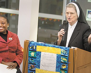 Sister Jerome Corcoran addresses an audience at Millcreek Children's Center in Youngstown to welcome Michele D. Grant as the center's new executive director. Grant resigned as director a month later. Sister Jerome, 96, continued as director, but she was notified in late May that she was no longer head of the school she founded.
