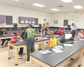 Chaney students in the Science, Technology, Engineering and Mathematics program participate in a summer-enrichment program at the school. In an exercise Wednesday, students looked for shapes in photographs of clouds.